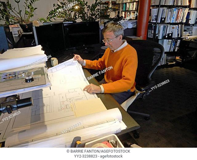 Architect Working on Blueprints in Office, Boston, Massachusetts, USA
