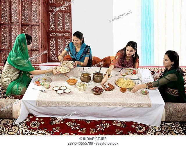 Muslim women having food during Id
