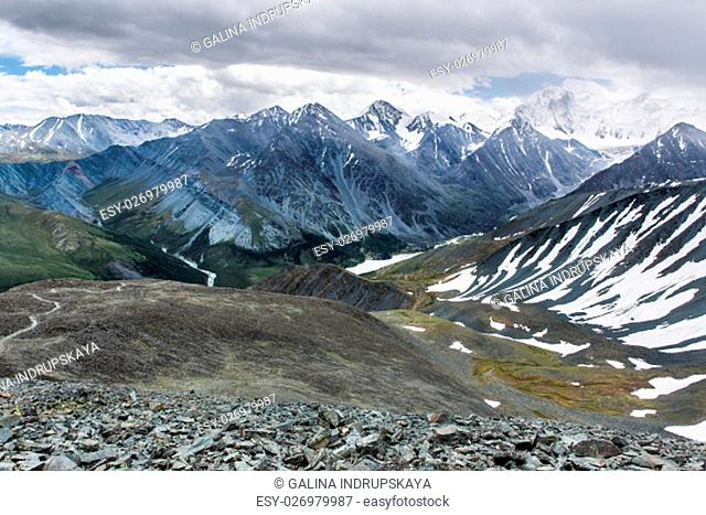 View from Karaturek mountain pass in cloudy weather. Karaturek is the most difficult mountain pass in Altai mountains. It could be passed on foot or on...