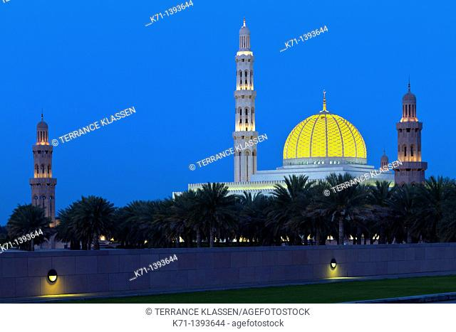 The Grand Mosque illuminated at night in Muscat, Oman