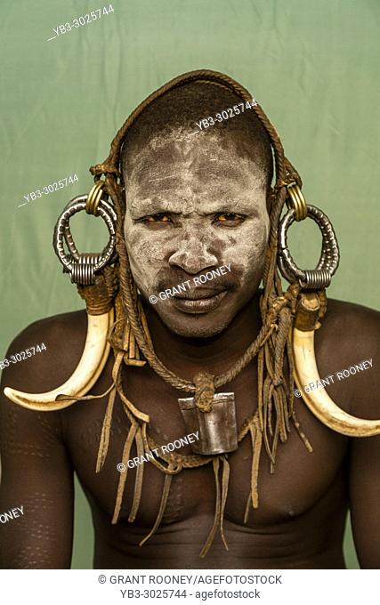 A Portrait Of A Young Man From The Mursi Tribe, Mursi Village, Omo Valley, Ethiopia