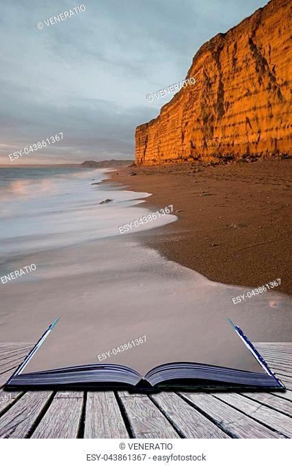 Creative book image of Beautiful sunset landscape image of Burton Bradstock golden cliffs in Dorest England