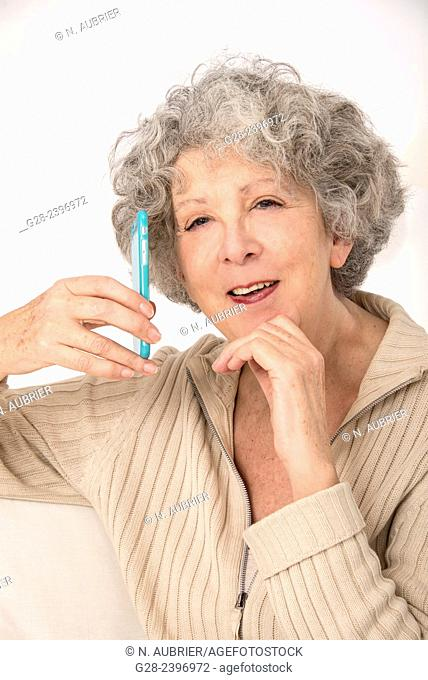 Beautiful surprised senior woman on the phone laughing