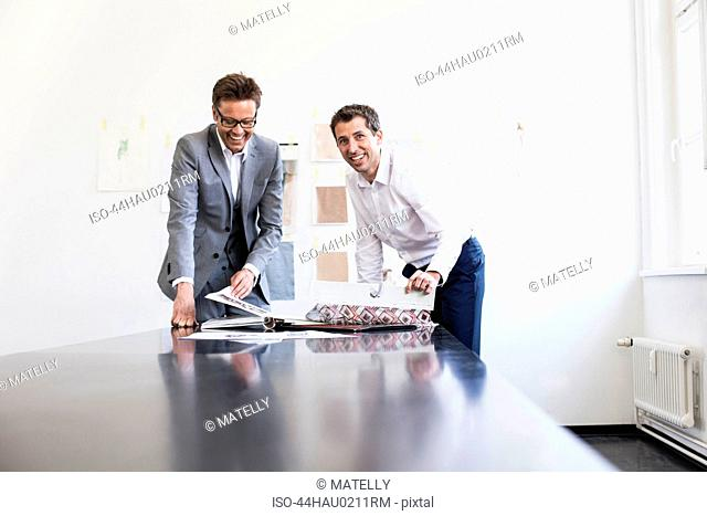 Businessman reading book in office