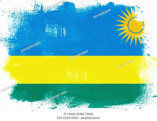 Flag of Rwanda painted with brush on solid background