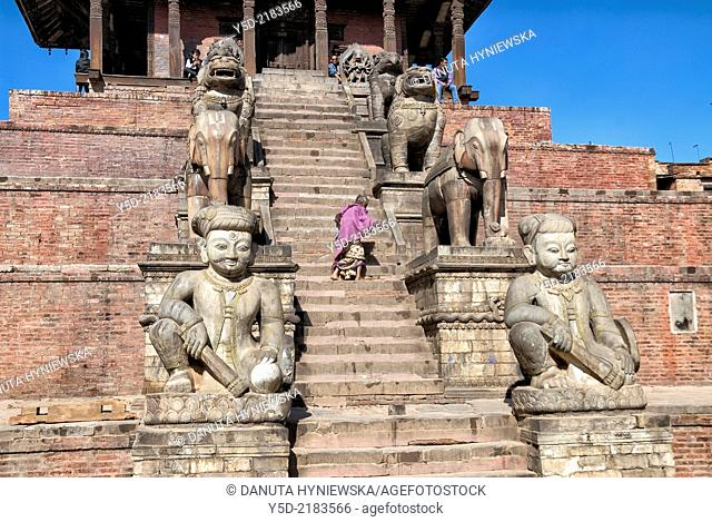 single old woman climbing stairs of Nyatapola Pagoda - UNESCO World Heritage, Taumadhi Square, Bhaktapur, Kathmandu Valley, Nepal