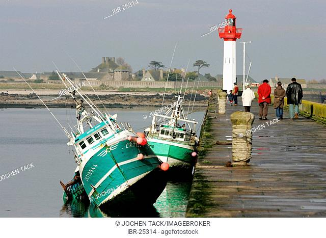 FRA, France, Normandy: Fishing boats in the port of St. Vaast La Hougue, at low tide. Behind, the small island of Tatihou