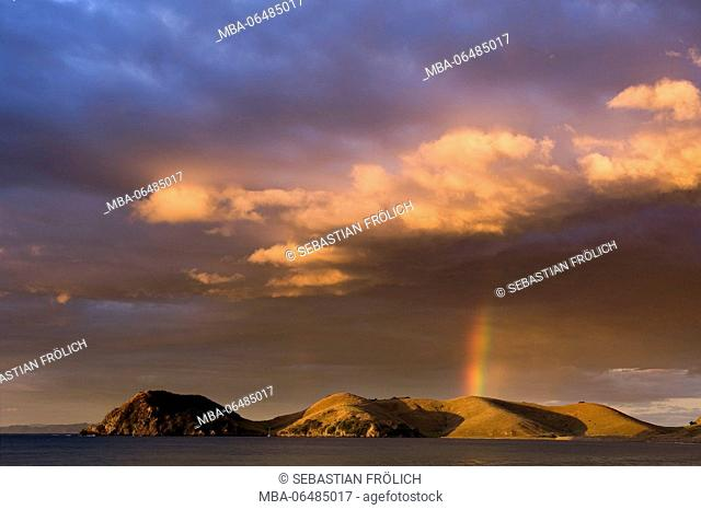 Dramatic beautyful clouds with rainbow on the coast of Coromandel, New Zealand