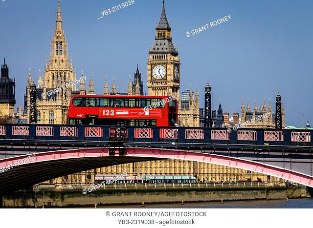 The Houses Of Parliament and Red London Bus Crossing Lambeth Bridge, London, England