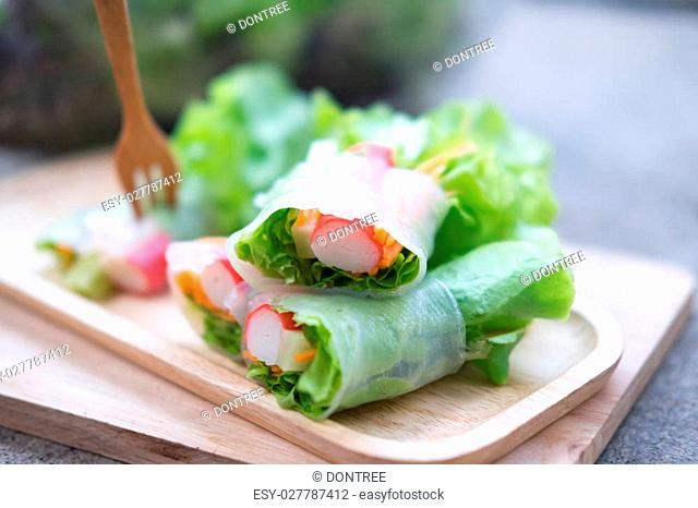 salad roll a healthy food diet calorie on wood tray