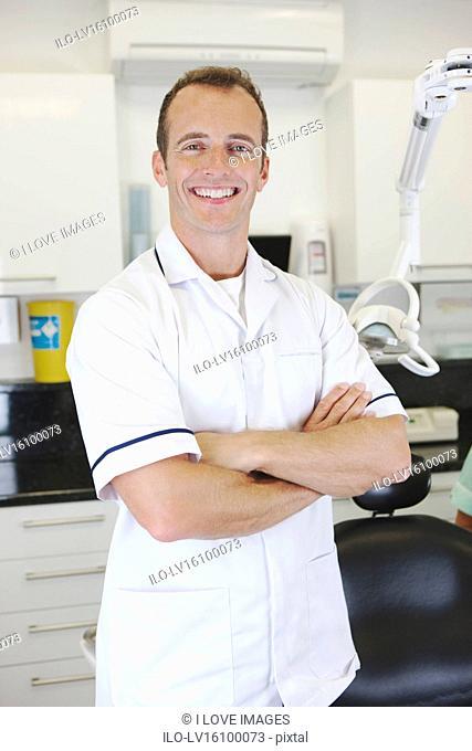 A male dentist in a dental surgery