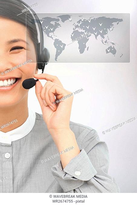Female executive talking on headphones