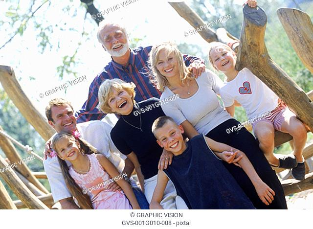 Portrait of a family sitting on a fence