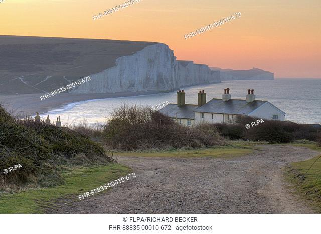 The Seven Sisters cliffs and coastguard cottages at dawn. From Seaford Head, South Downs, East Sussex, England. February