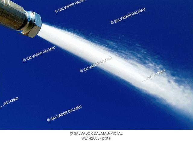 expelling water pressure hose,outdoor water pressure,location girona,catalonia,spain,europe,