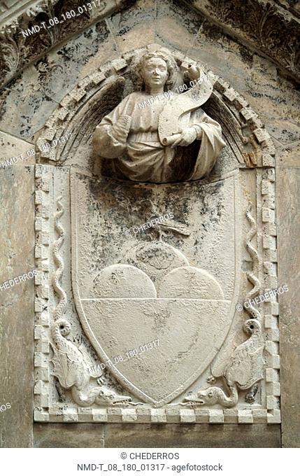 Close-up of a statue carved on a wall, Venice, Veneto, Italy