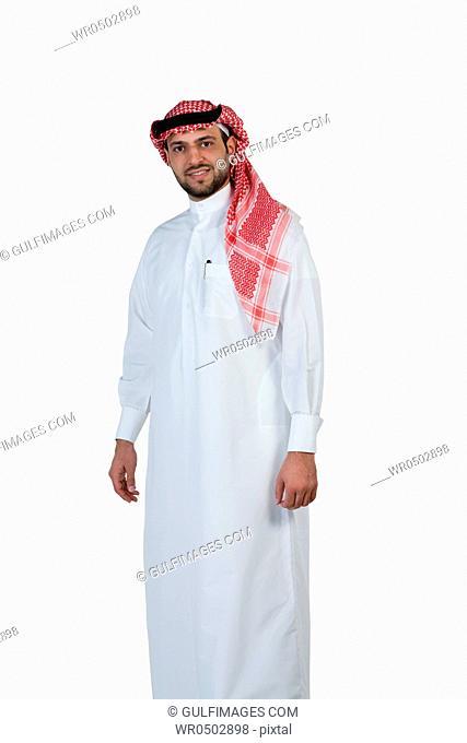 Arab man wearing a traditional dress, looking at the camera