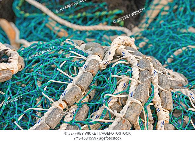 Pacific herring purse seine net and lead line on stack on fishing boat in Sitka, Alaska