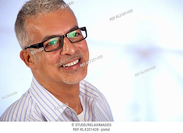 Portrait businessman wearing glasses smiling old