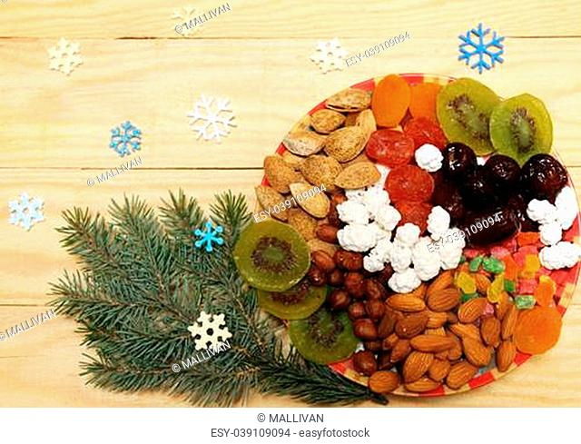 Still life with nuts and dried fruit in a Christmas style