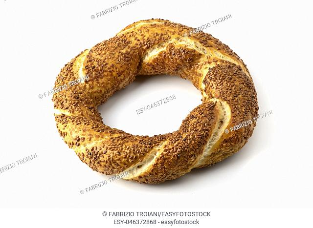 Simit, widely know as turkish bagel, on a white background