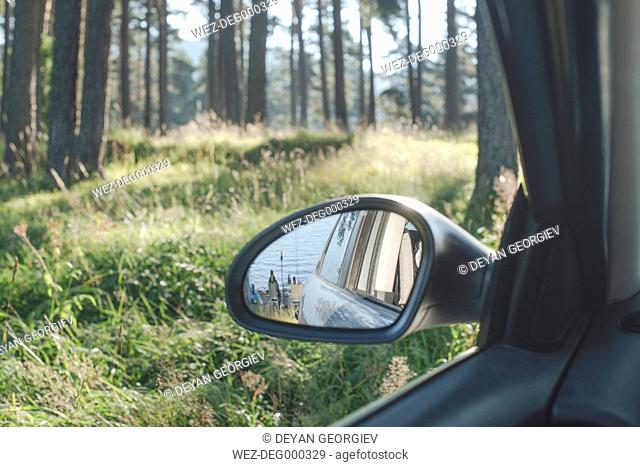 Bulgaria, Car in the woods, reflection in the wing mirror