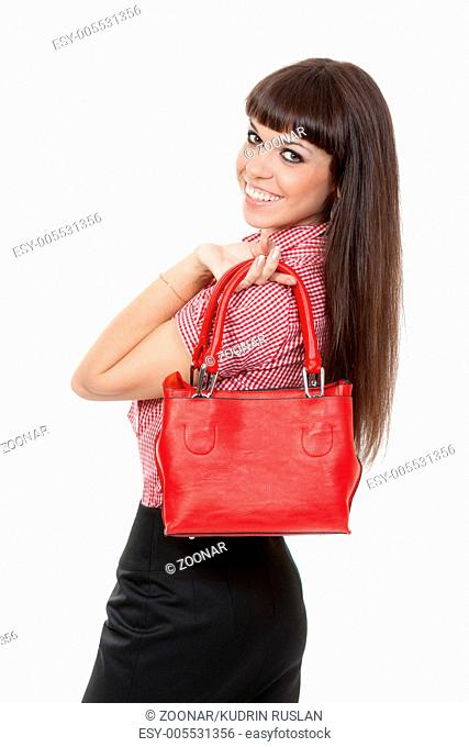 Portrait of a girl with a fashionable red handbag