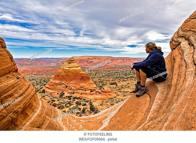 USA, Arizona, Page, Paria Canyon, Vermillion Cliffs Wilderness, Coyote Buttes, tourist enjoying the view on red stone pyramids and buttes