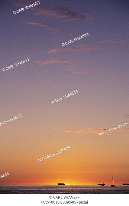 Beautiful color gradations in sunset sky over ocean