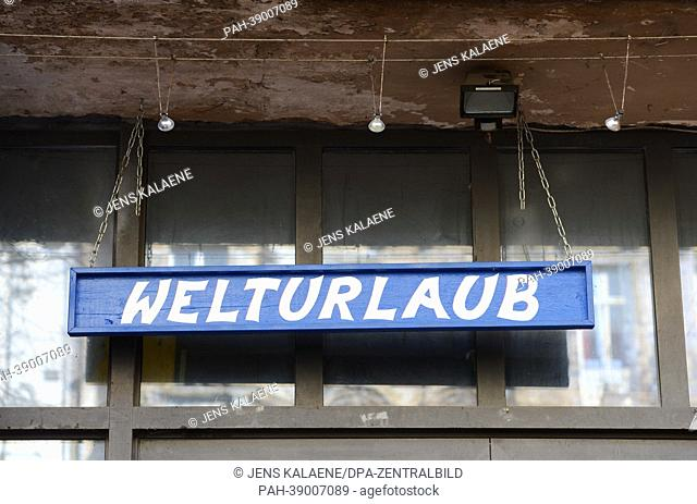 The word 'Welturlaub' (lit. world holiday) is written above the entrance to an arts gallery on the ground floor of the closed-down former arts and artists'...