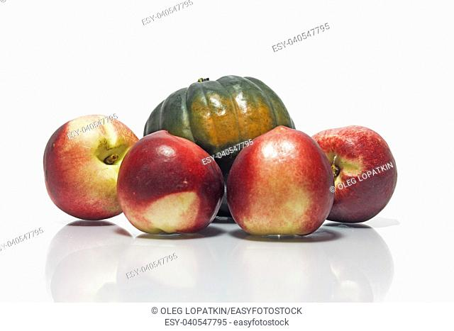 pumpkin and peaches on a white background