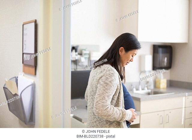 Pregnant Chinese woman in hospital room