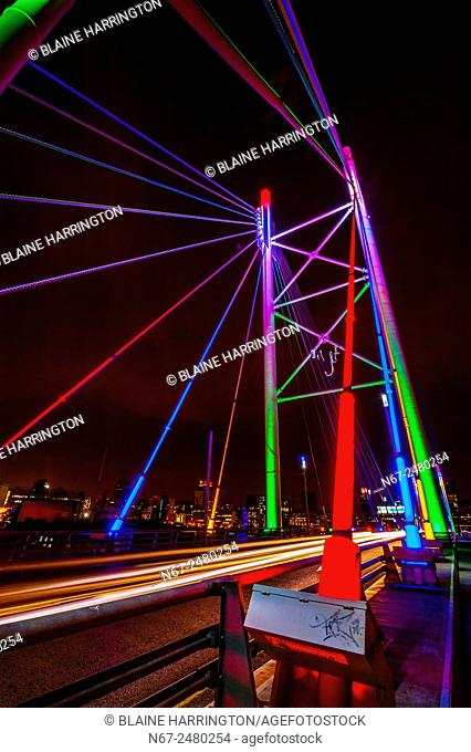 The Nelson Mandela Bridge connects the Braamfontein and Newtown areas of Johannesburg, South Africa. It has two pylons. It was constructed over 42 railway lines...