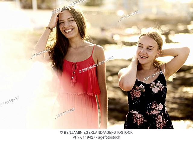 two women, friends, at beach, togetherness in holiday destination Chersonisoss, Crete, Greece
