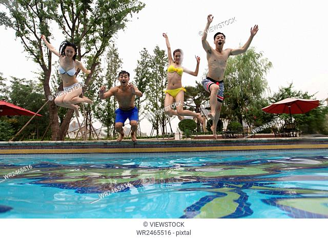 Young men and women swimming