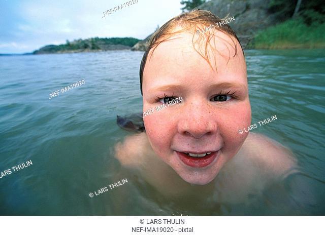 Portrait of a girl in water