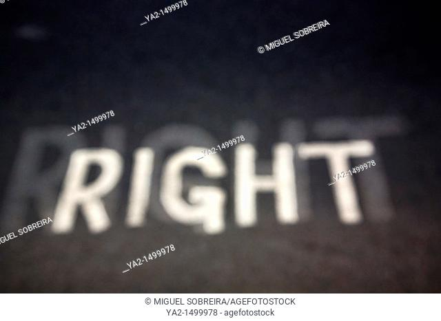 The word right painted on street - blurred