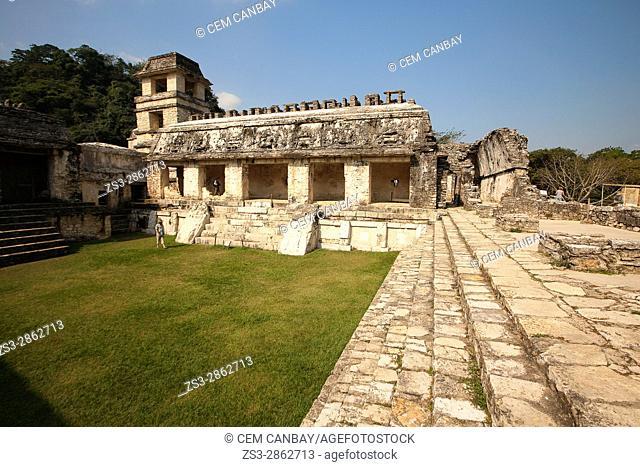 Visitors in front of the Palace-El Palacio at the Patio de los Cautivosin Palenque Archaeological Site, Palenque, Chiapas State, Mexico, Central America
