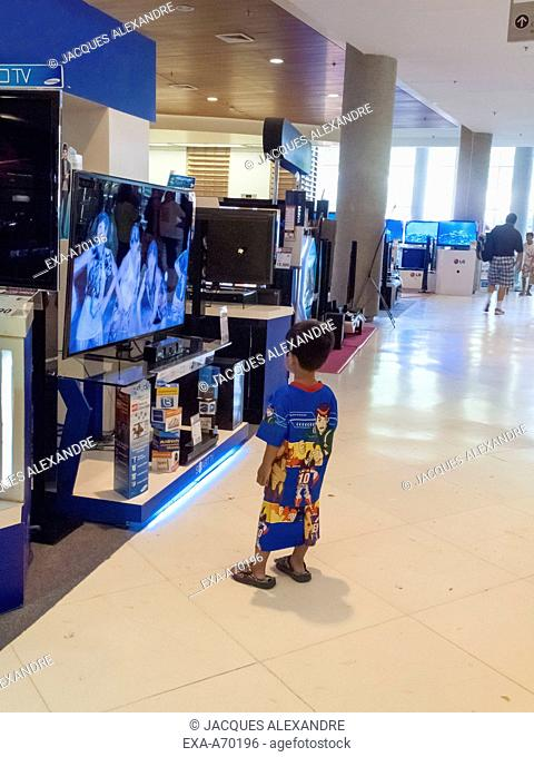 child fascinated by TV screens