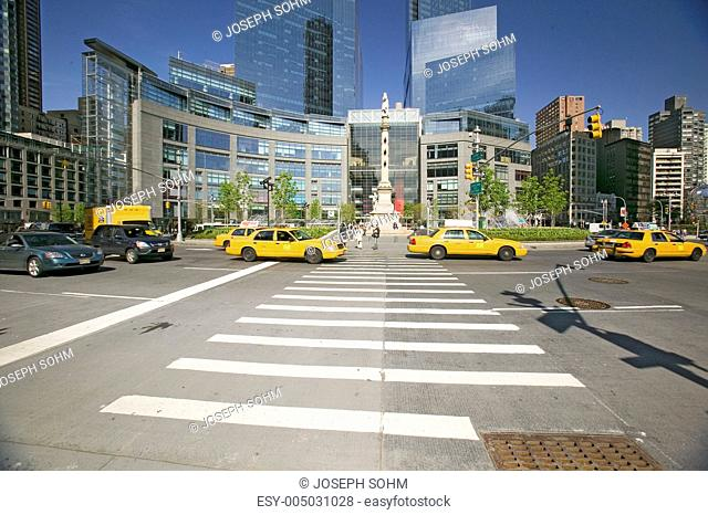 Yellow cabs and taxies speed by Columbus Circle, Manhattan, New York City, New York