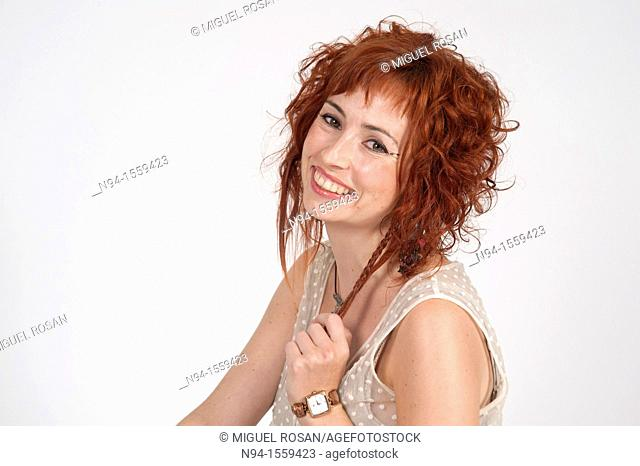 Young woman posing redhead during a study session