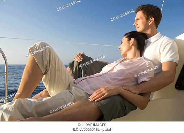 A couple relaxing on a boat