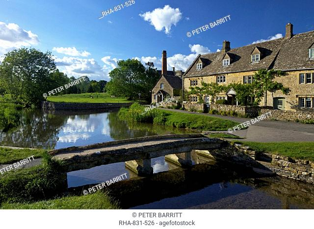 River Eye flowing through the pretty village of Lower Slaughter, the Cotswolds, Gloucestershire, England, United Kingdom, Europe