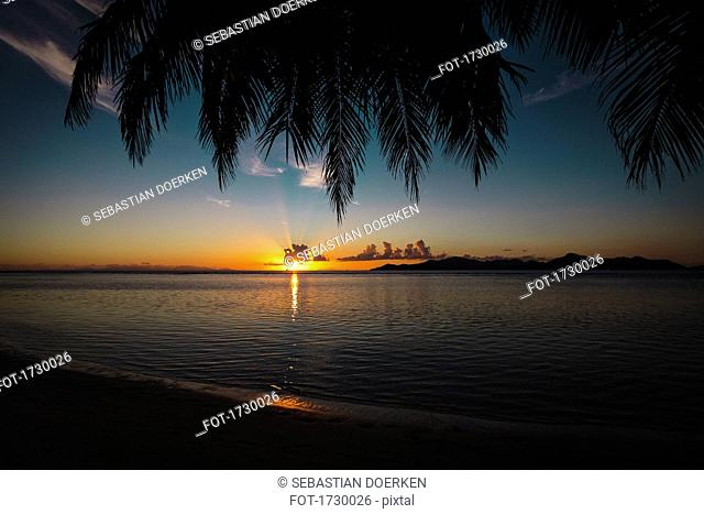 Scenic view of sea against sky during sunset, Island of La Digue, Seychelles