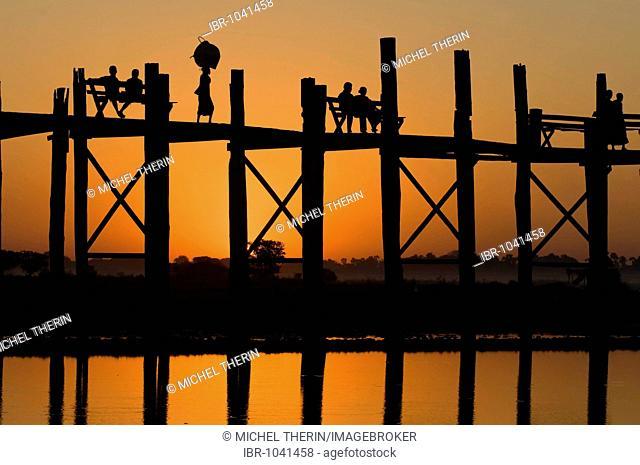 U Bein Bridge at sunset, Thaungthaman lake, Amarapura, Burma, Myanmar, South East Asia