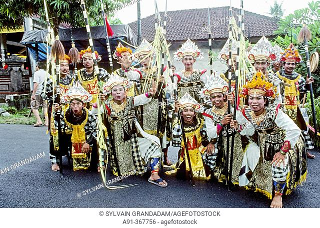 Baris dancers at an hinduist religious ceremony (odalan) in the Celuk Temple. Bali island. Indonesia
