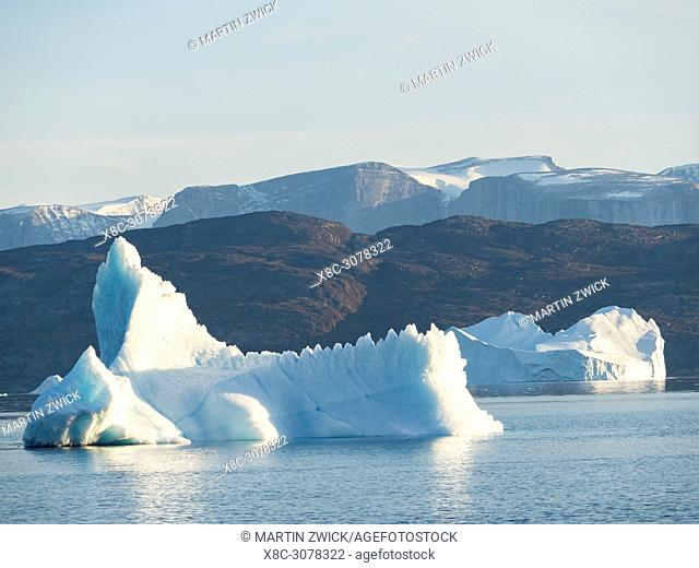 Icebergs in the Uummannaq fjord system in the north of west greenland. Nuussuaq Peninsula in the background. America, North America, Greenland, Denmark