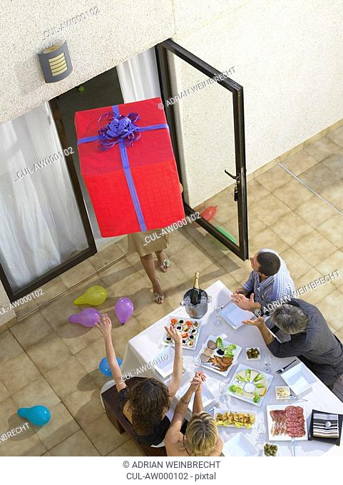 Arriving with gifts to the party