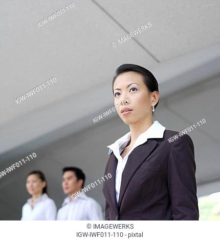 Low angle view of a businesswoman looking away