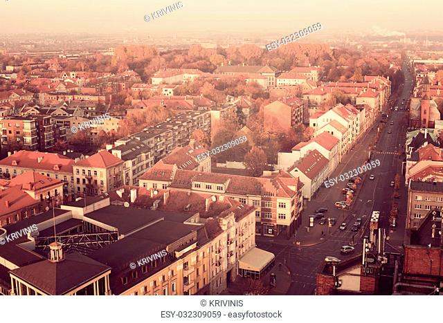 Representative aerial picture of Klaipeda, Lithuania in autumn sunset. Lights of Liepu street
